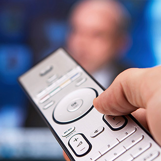 Remote control pointed at screen
