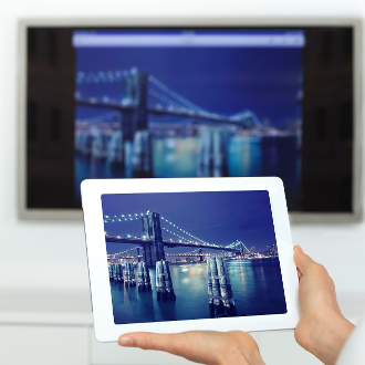 Woman using digital tablet with SmartTV